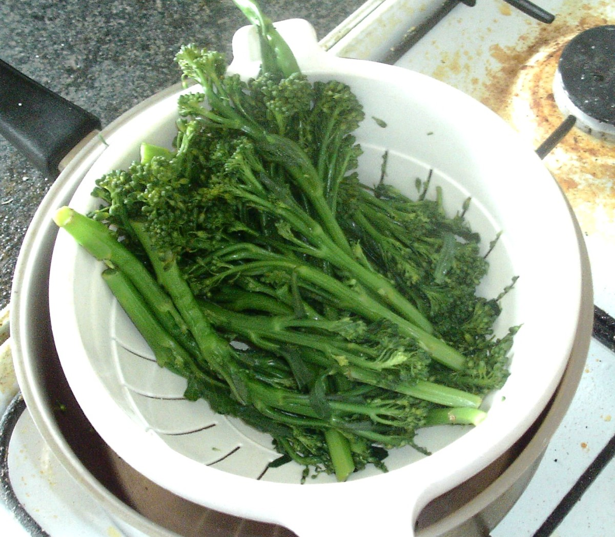 Tenderstem broccoli is drained and left to cool
