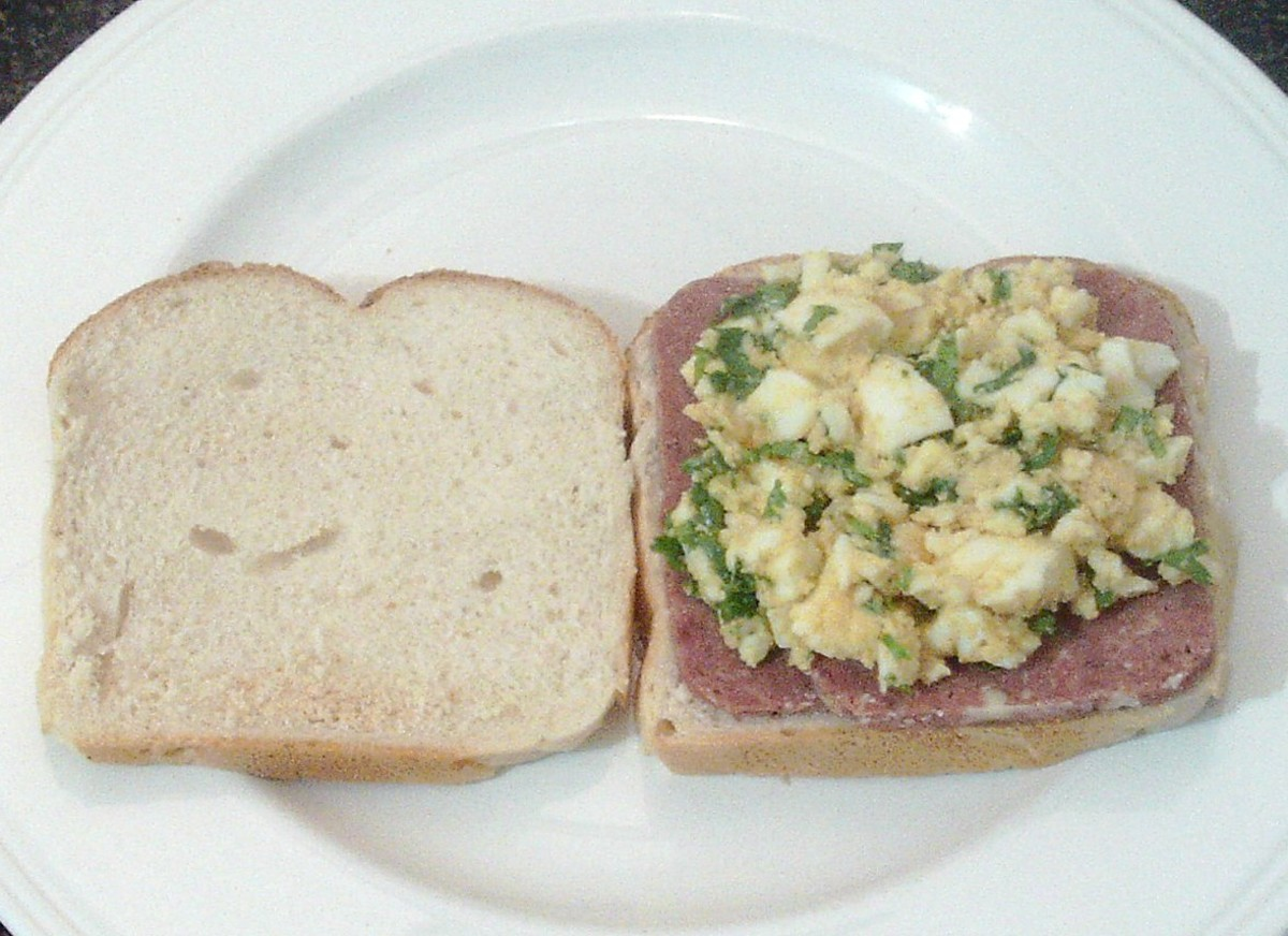 Mashed egg combination is spread over the corned beef