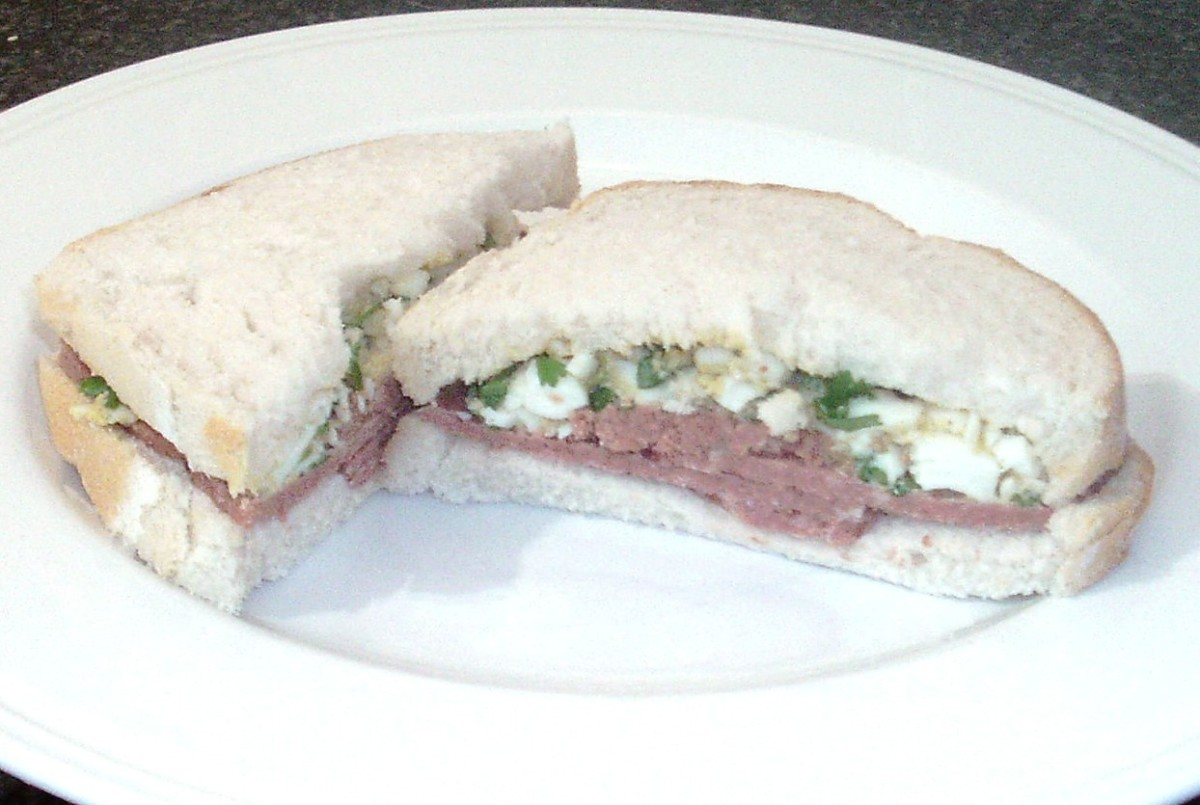 Boiled egg mashed with parsley accompanies the corned beef in this tasty sandwich