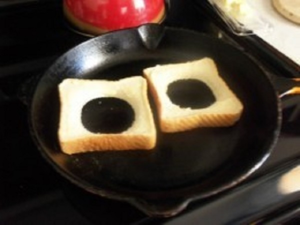 Add toast un-buttered side down in a skillet.