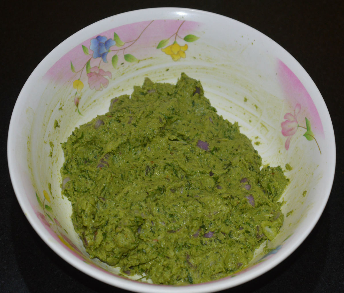 Make the dough spreadable by adding a teaspoon water and mixing well.