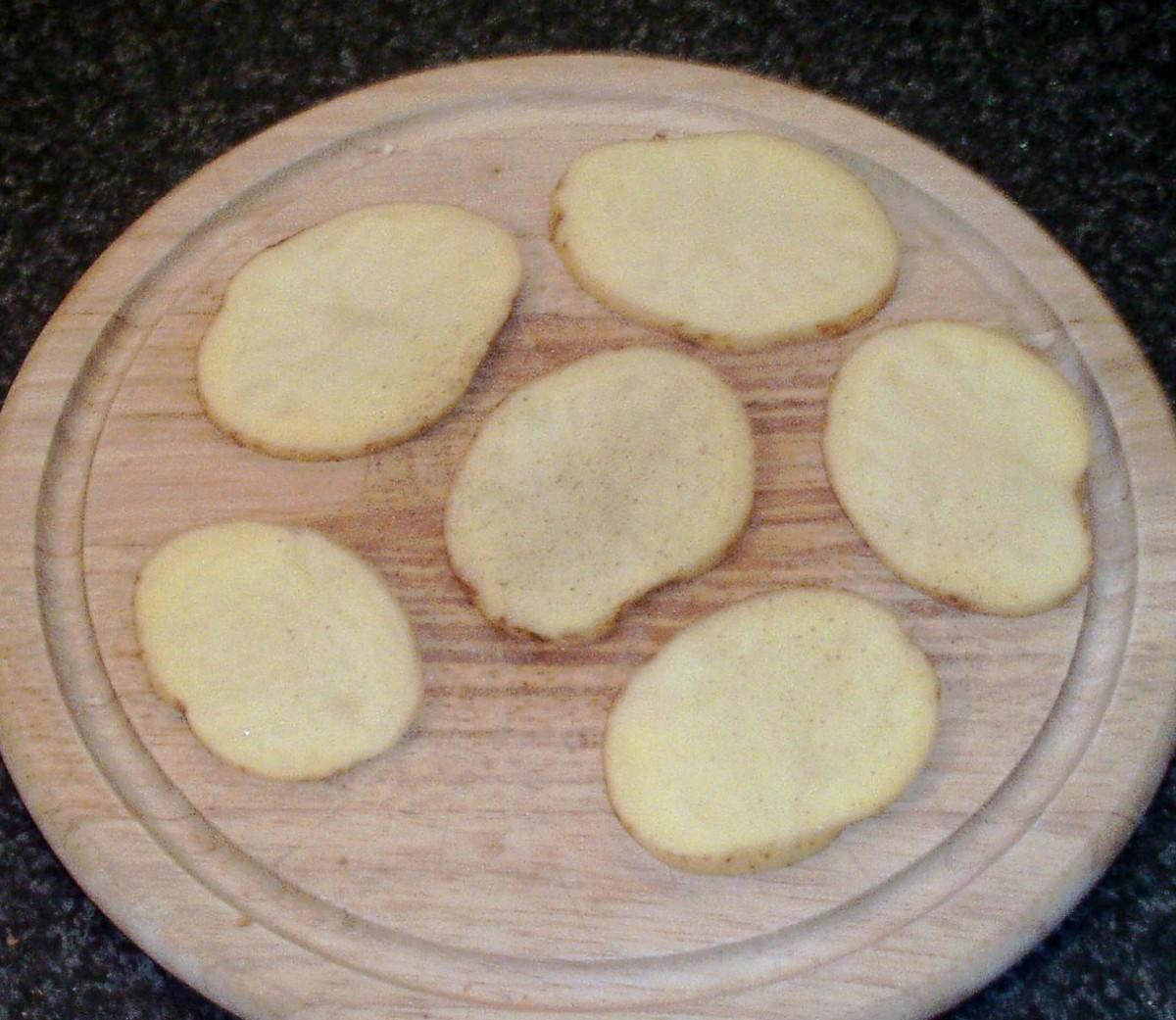 Potato slices are seasoned