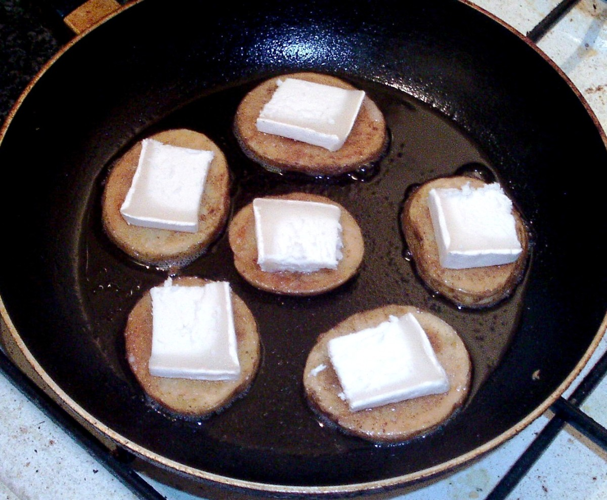 Goats cheese squares are laid on frying potato discs
