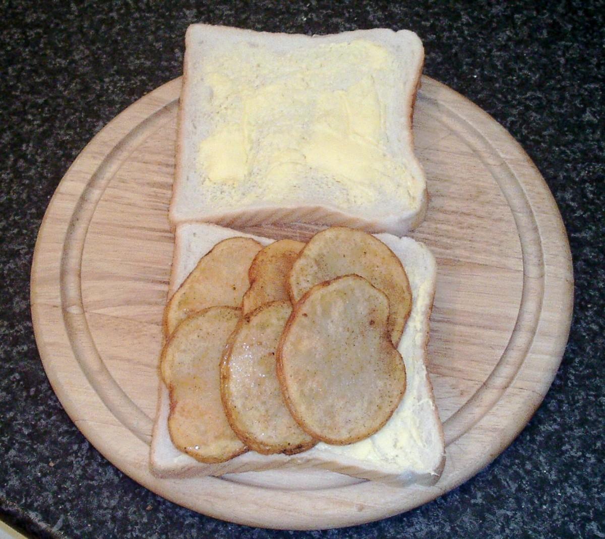 Potato slices are laid on slice of bread