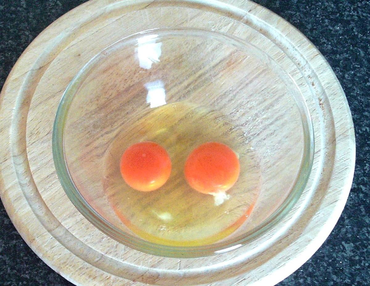 Eggs broken in to mixing bowl