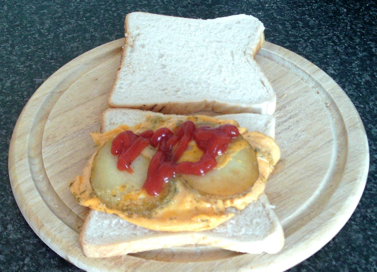Optional tomato ketchup is added to fried potato omelette