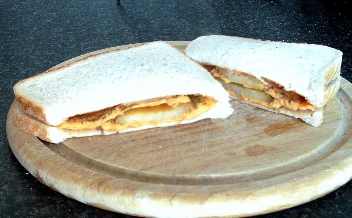 Fried Potatoes in Cheesy Omelette Sandwich