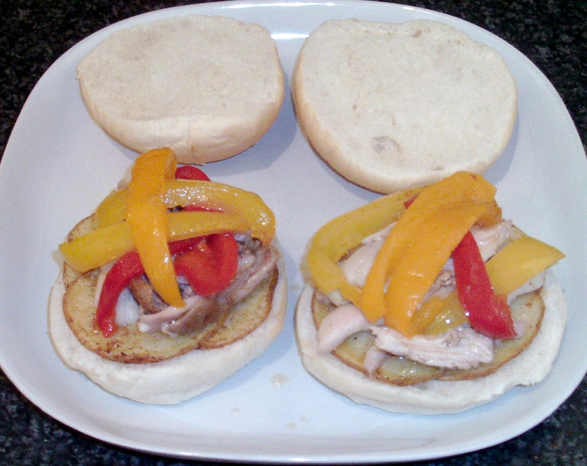 Bell pepper slices are laid on top of chicken meat