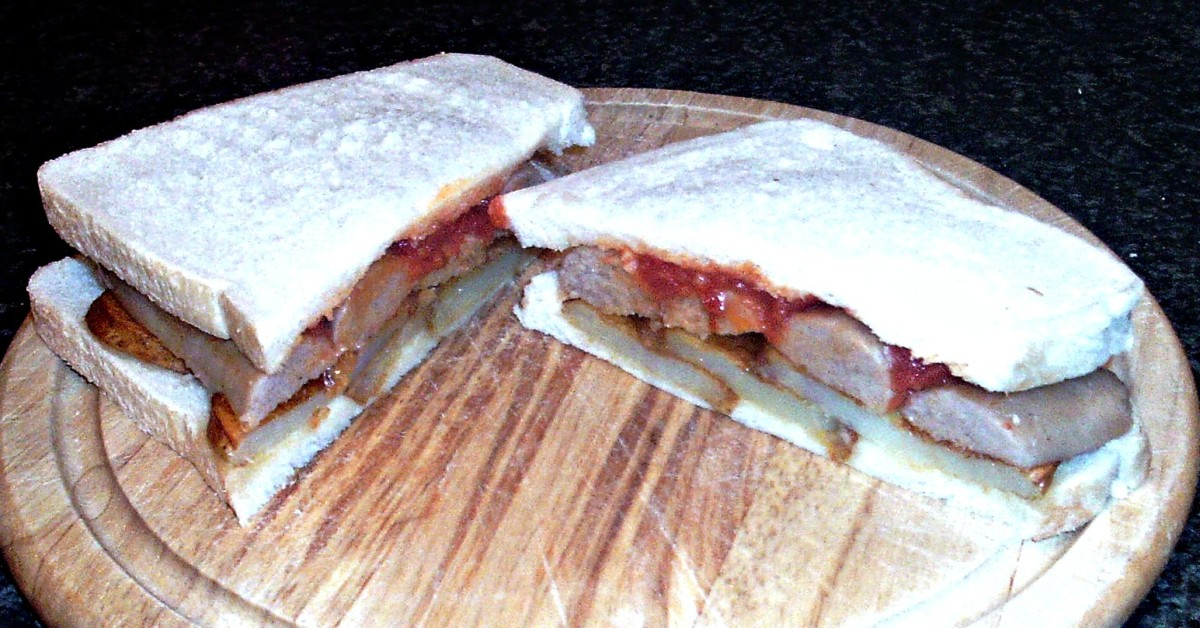 Fried Potatoes, Sausages and Spicy Tomato Sauce Sandwich