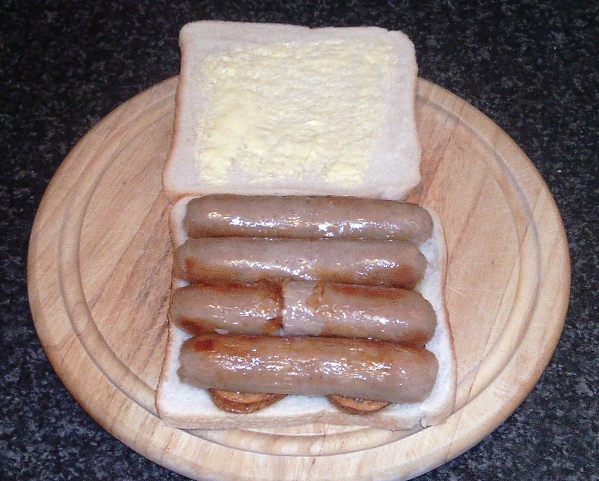 Halved sausages are laid on fried potatoes