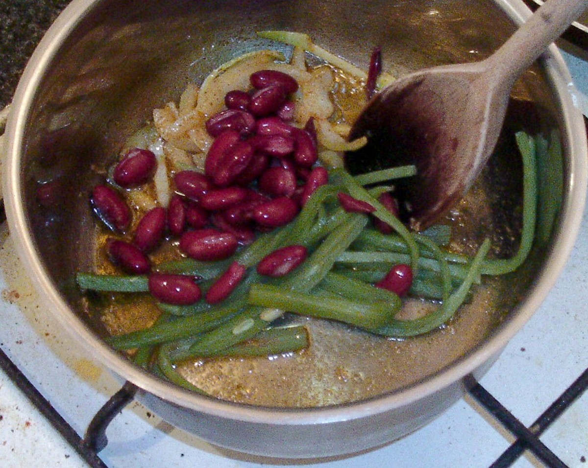beans are added to hot spice mix