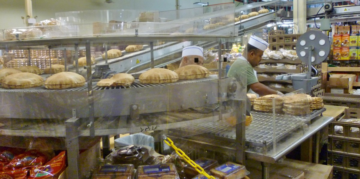 Workers packaging up the freshly baked pita bread