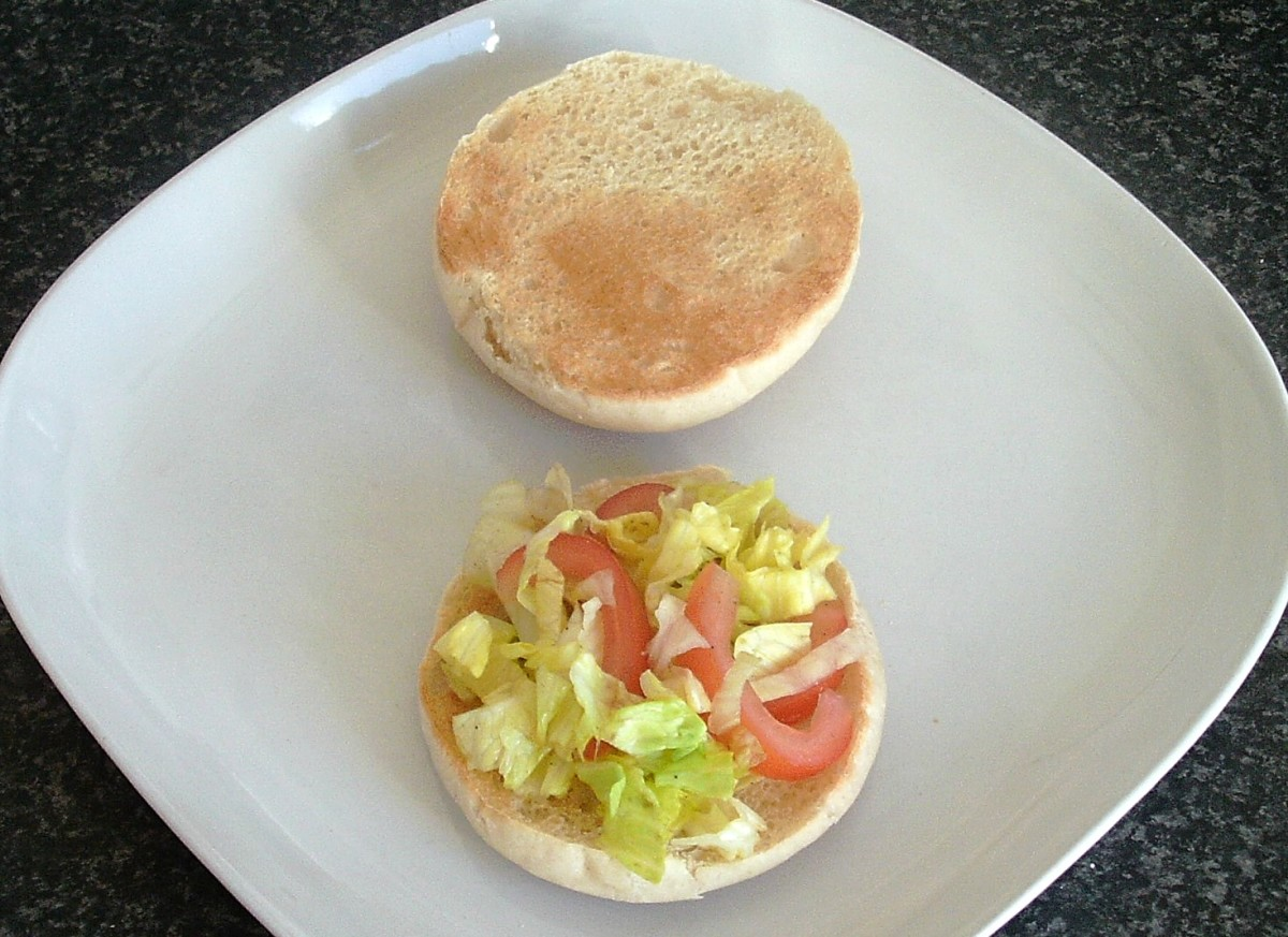 Combined tomato and lettuce on toasted roll
