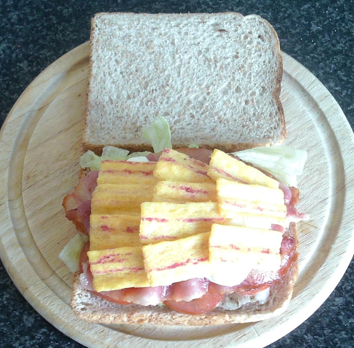 Crispy bacon corn snacks are arranged on top of garlic mayo