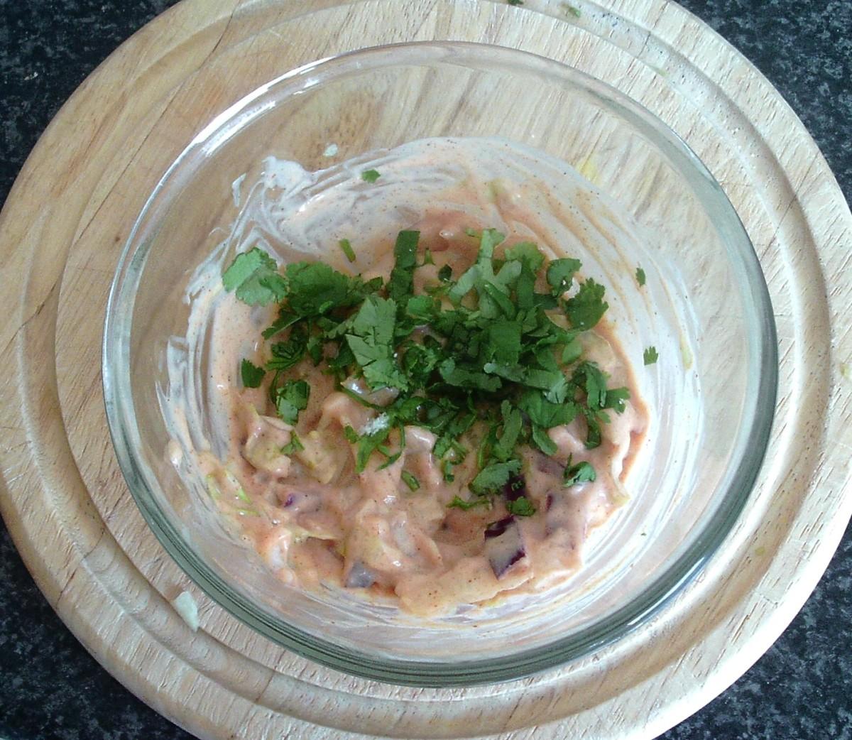 Coriander/cilantro is stirred through chilli sauce