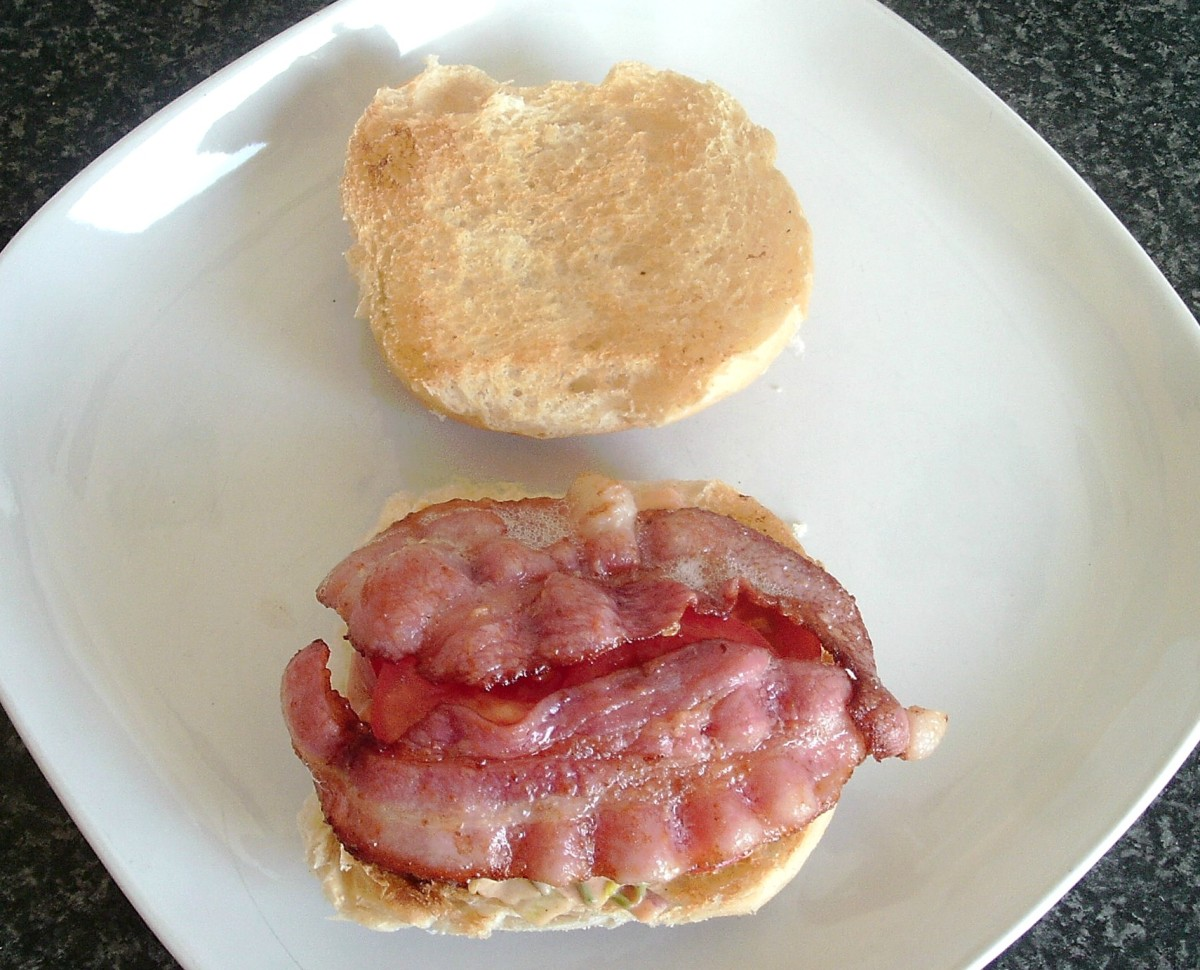 Bacon tops the tomato slices