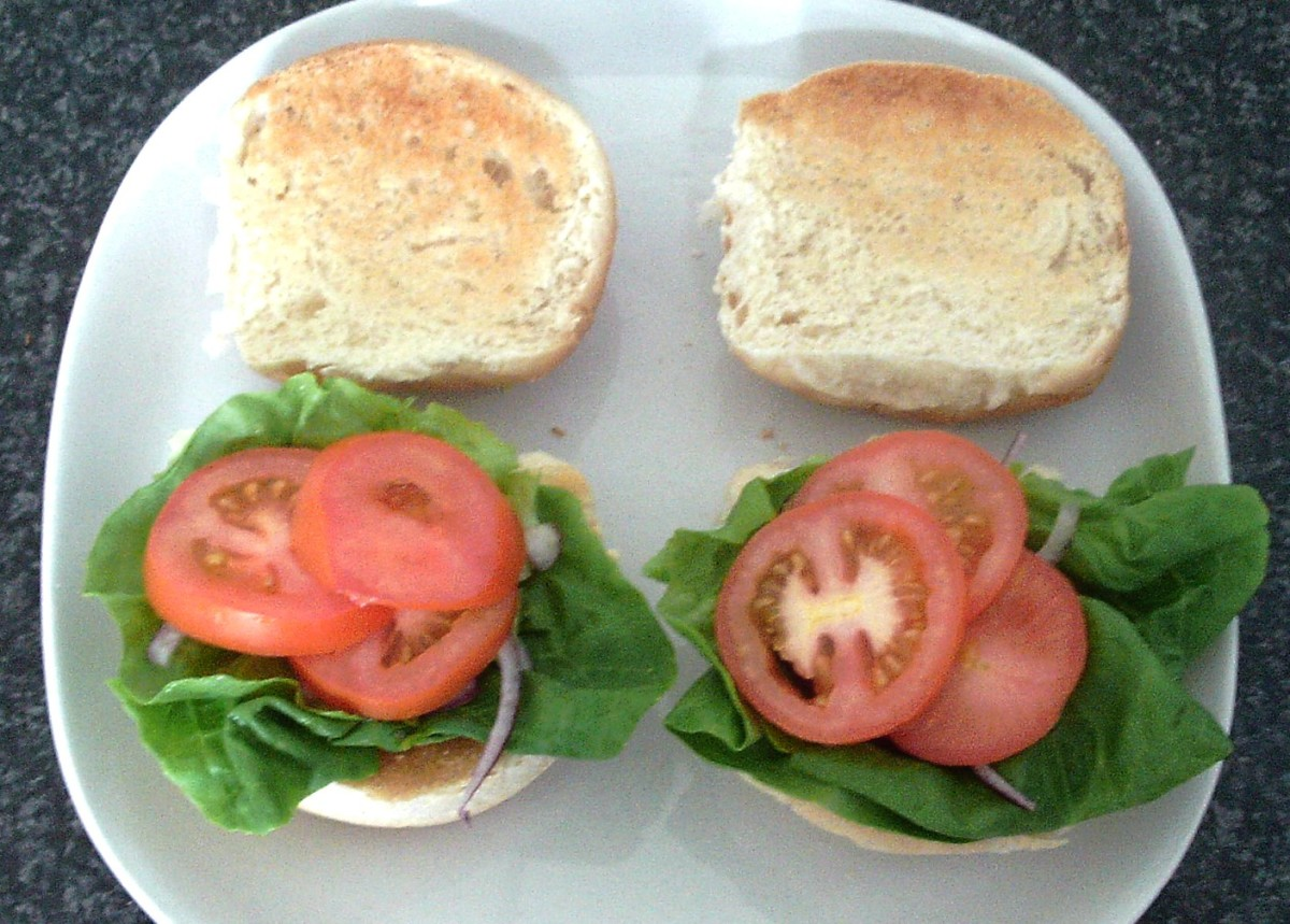 Sliced tomato on lettuce and onion