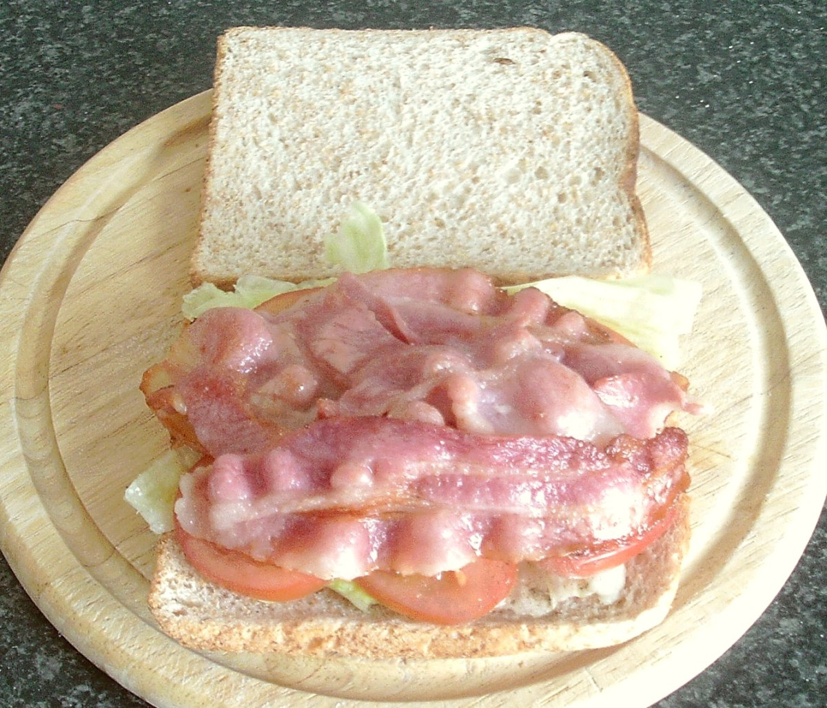 Bacon is laid on top of lettuce and tomato