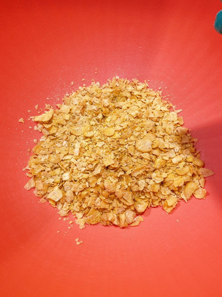 In a medium bowl, add the crushed cornflakes.