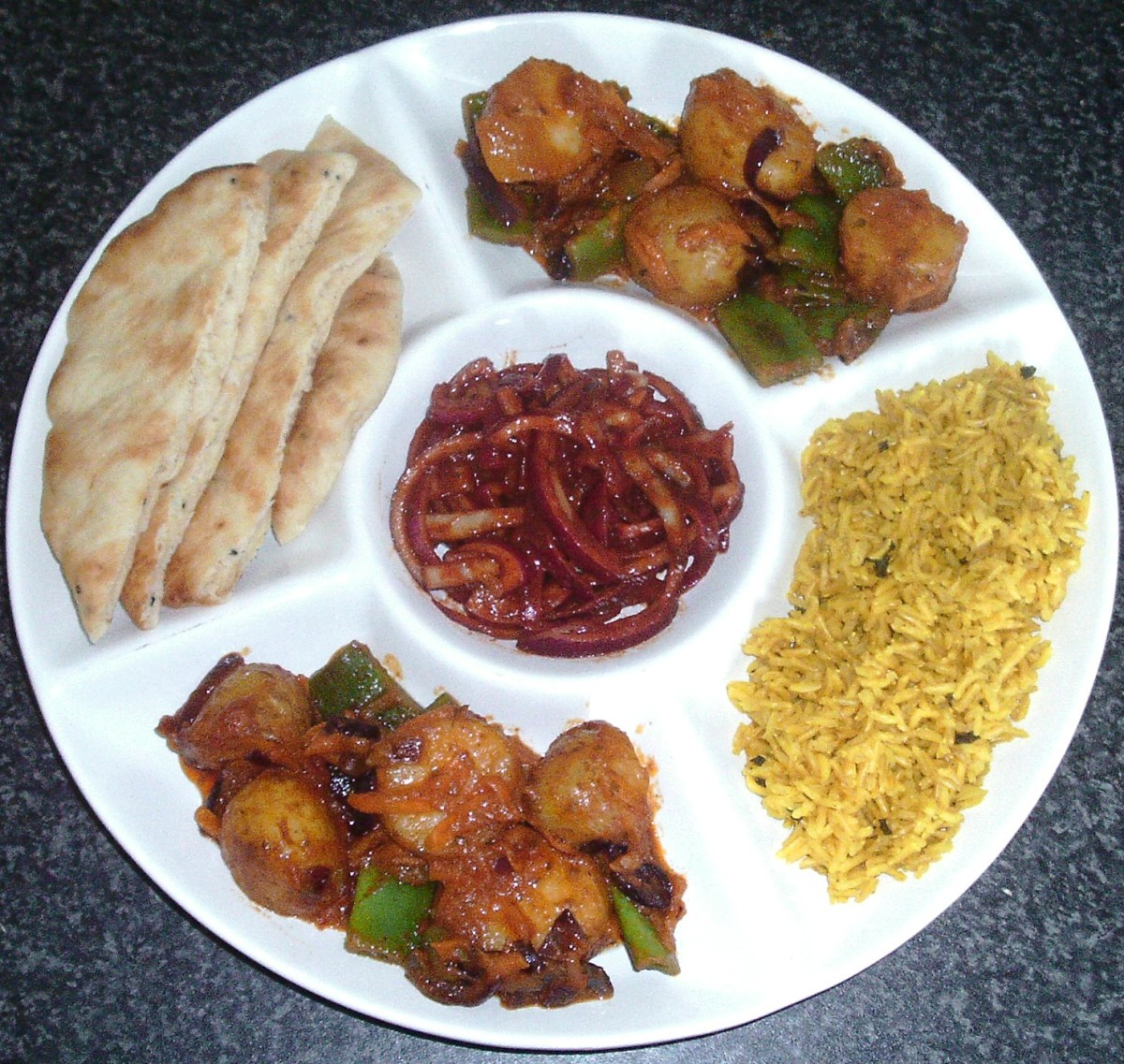 Potato and green bean jalfrezi with turmeric brown rice, spiced onions and naan bread