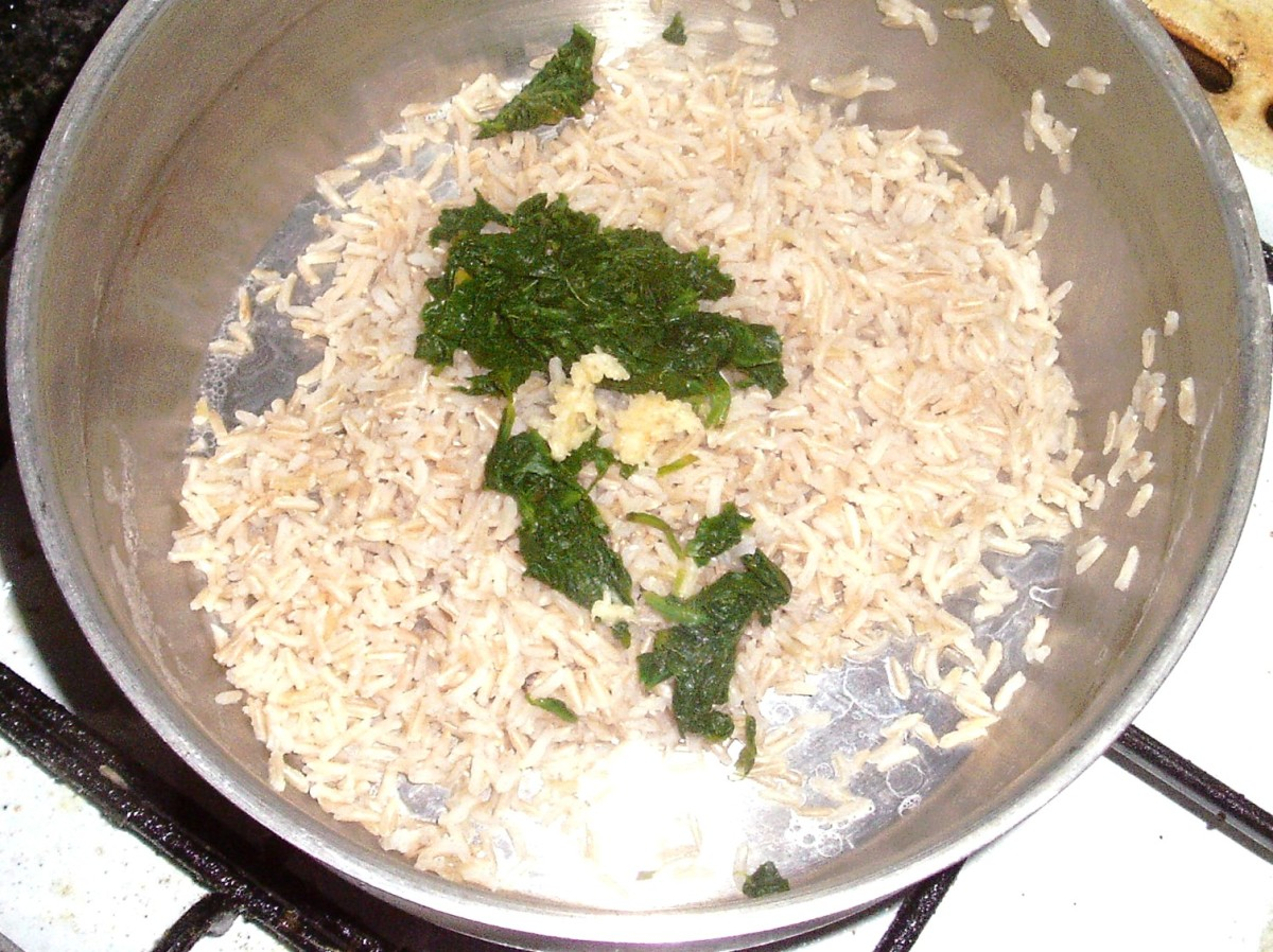 Spinach and garlic are added to cooked rice
