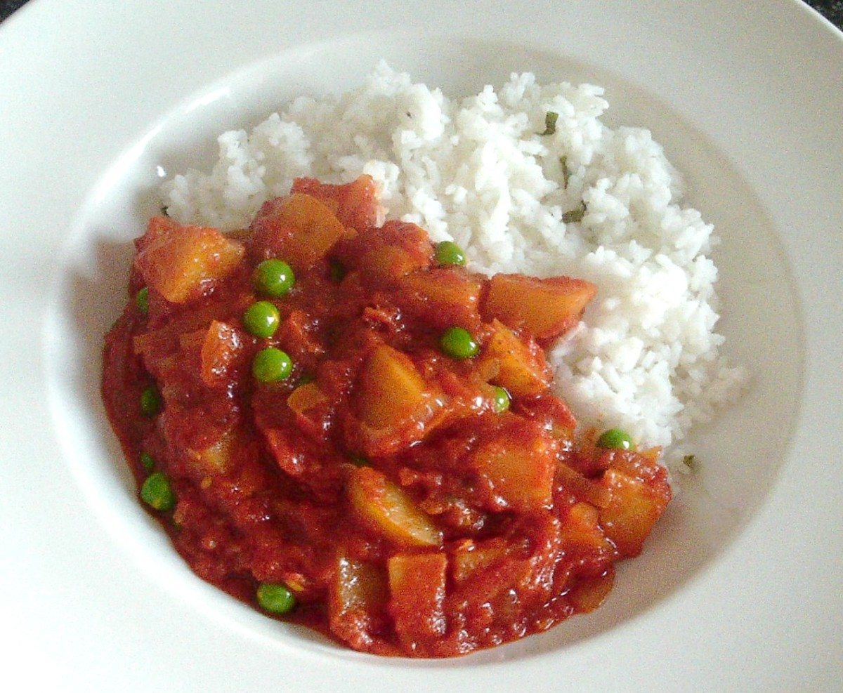 Potato and pea curry is served with a bed of minted rice