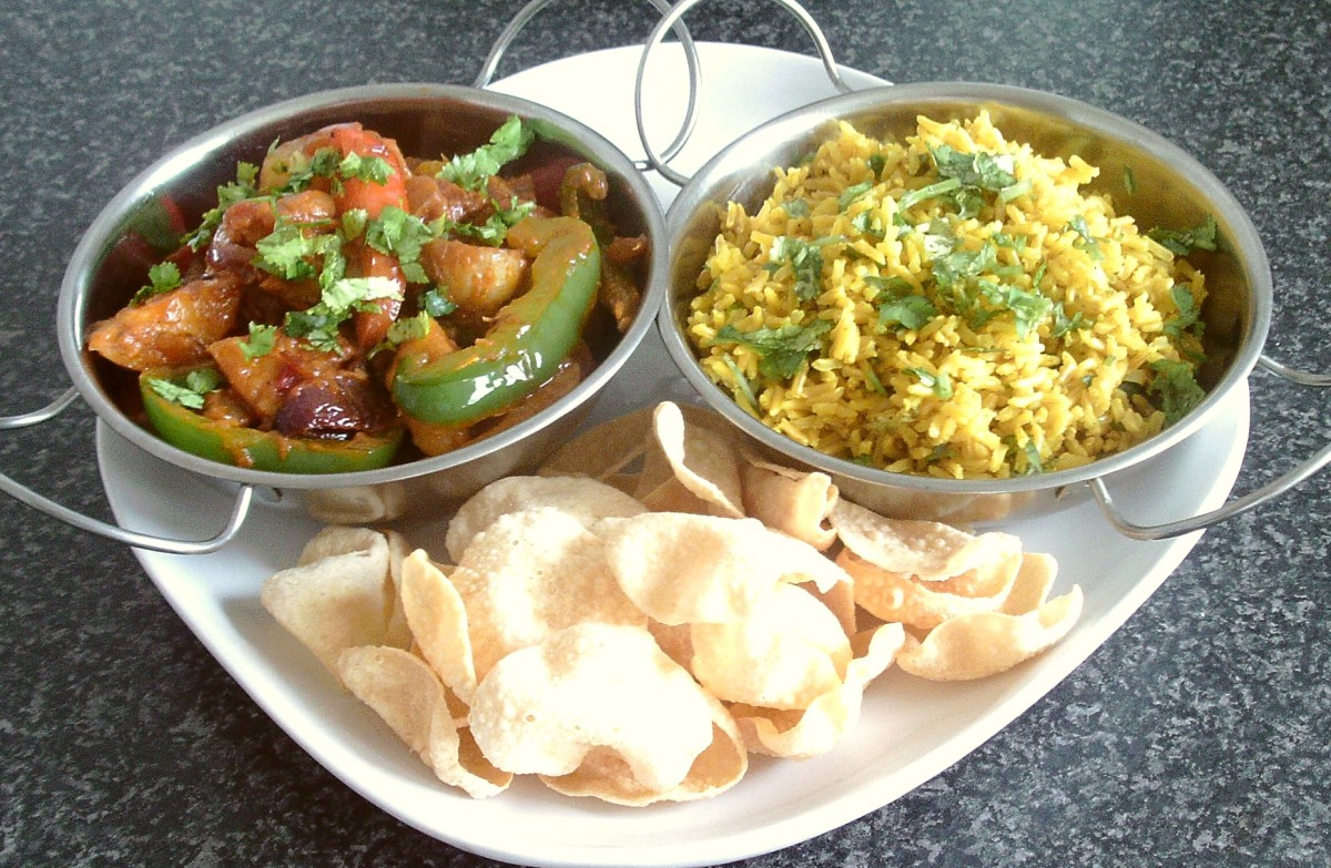 Potato and bell pepper rogan josh with turmeric and coriander rice and mini poppadoms