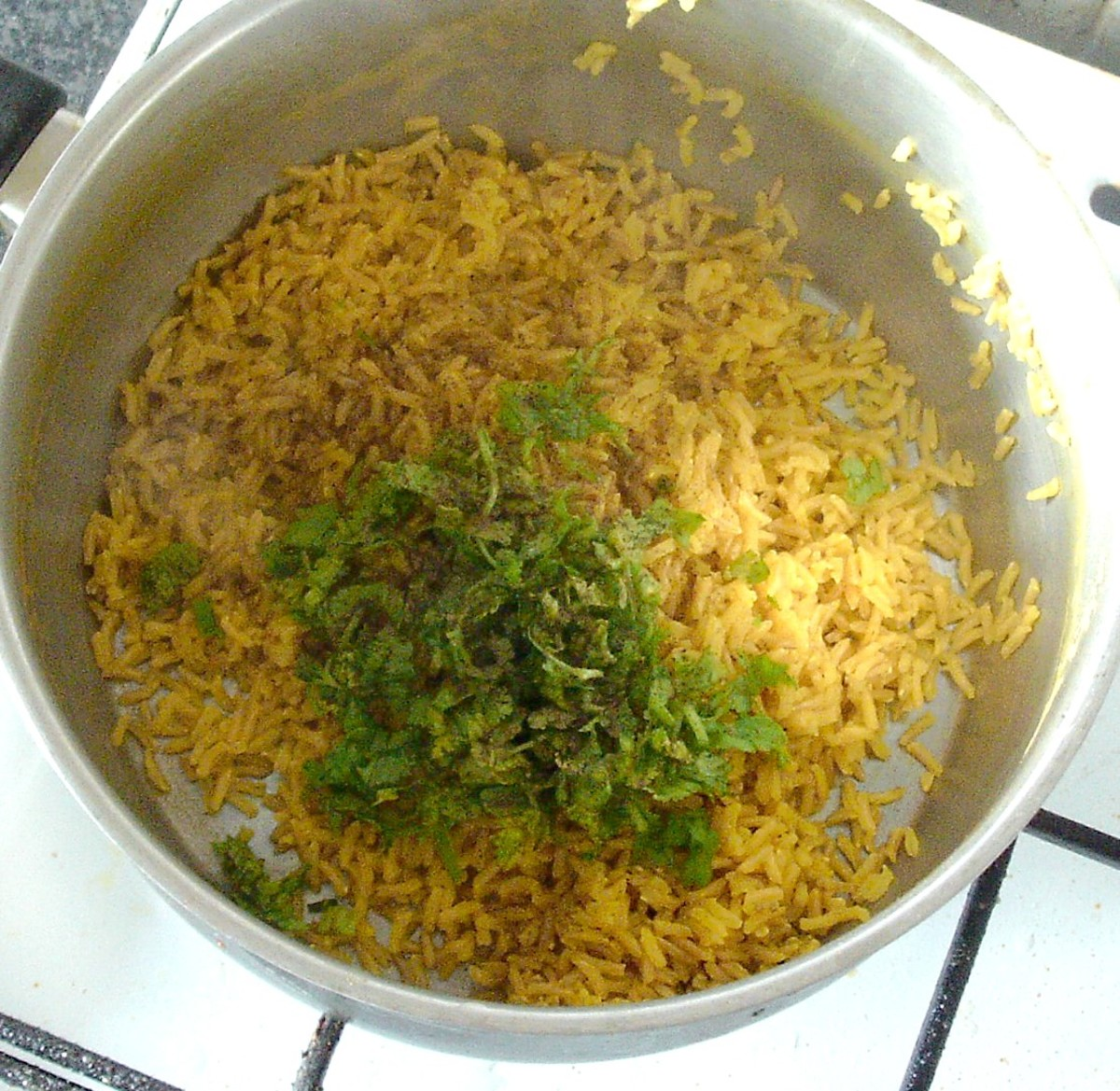 Coriander (cilantro) and black pepper are added to turmeric brown rice