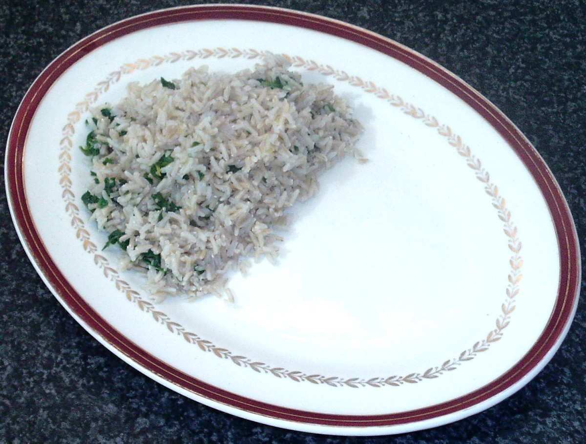 Spinach and garlic rice is arranged on serving plate