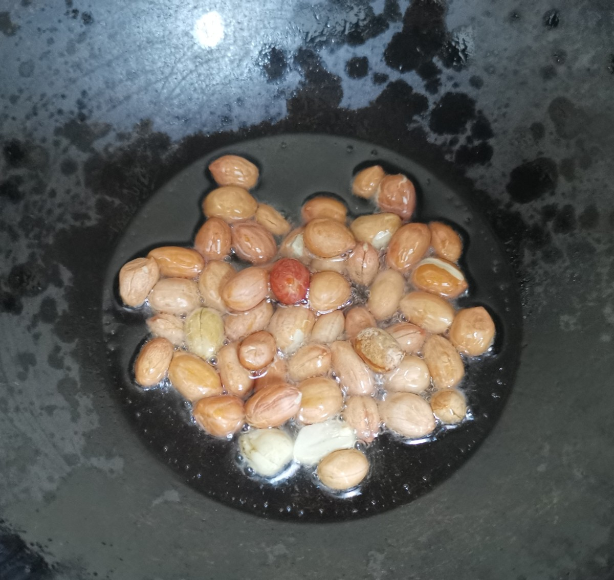 Add oil to a pan. Fry the peanuts till they become crunchy. Set aside.