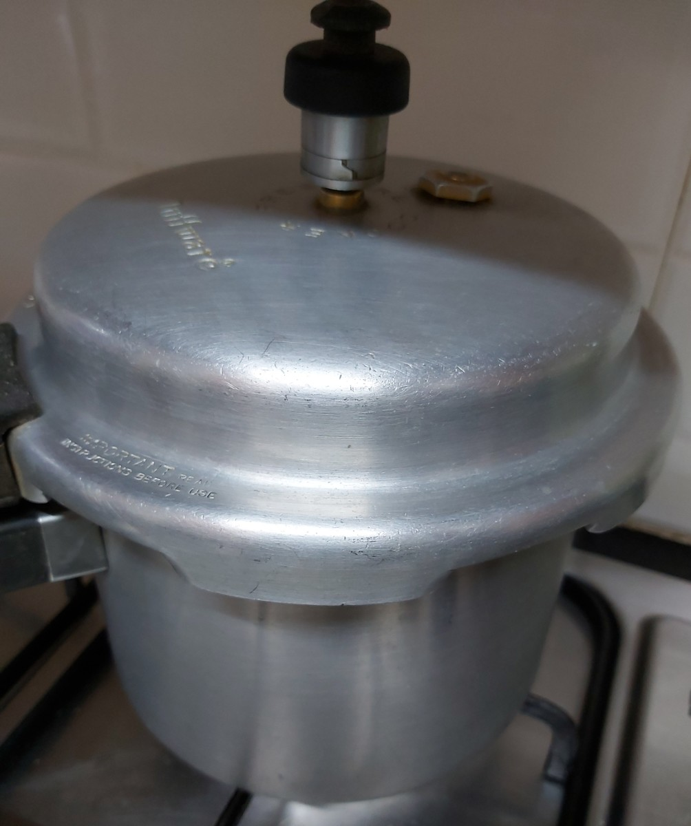 Close the lid and cook until 4-5 whistles, or until the dal is well cooked. Switch off the heat and let the pressure release by itself.