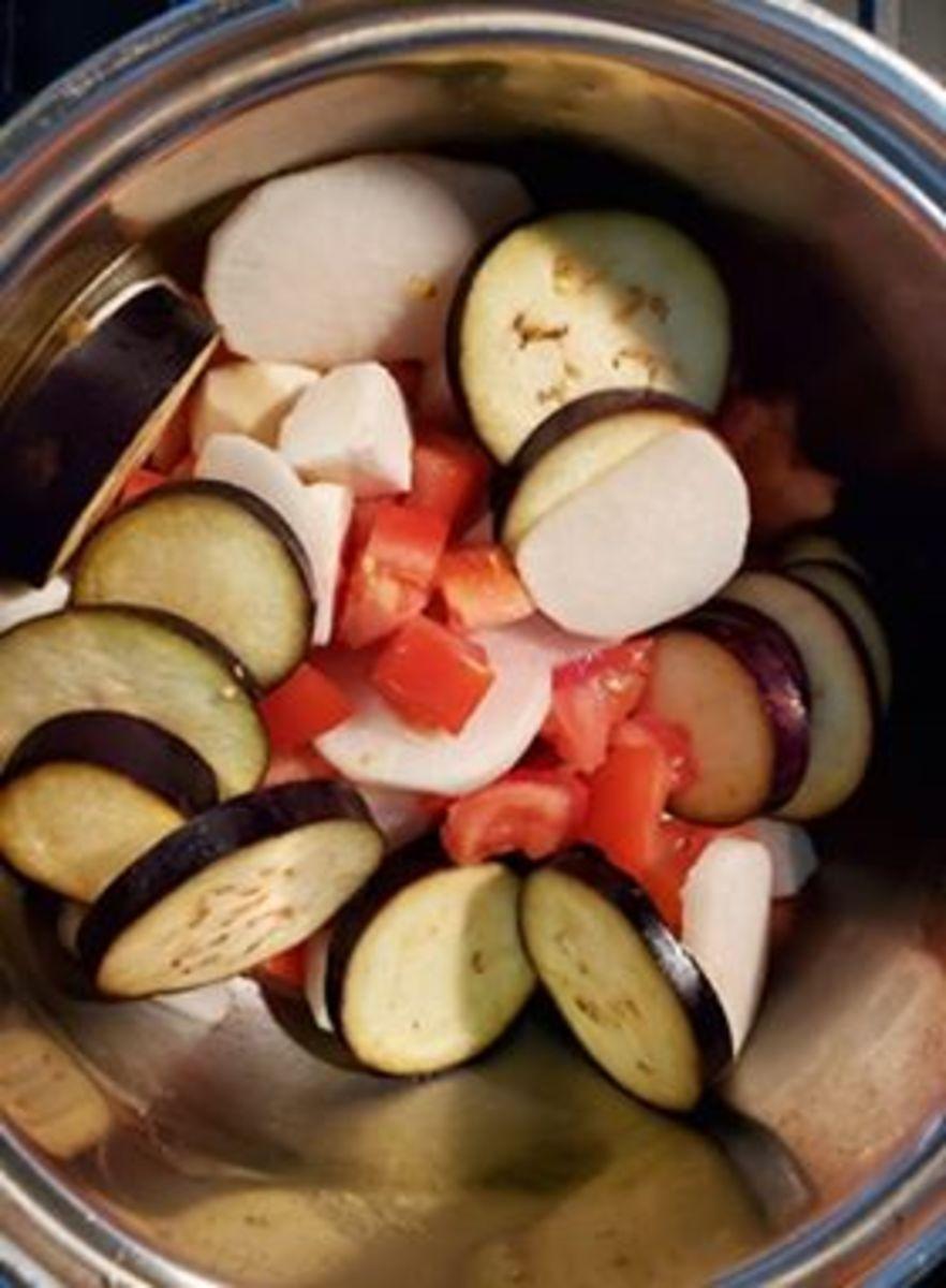 Step 2: Saute vegetables in oil.