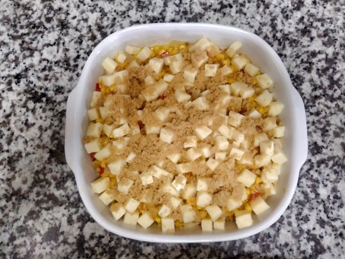 Add the cubled cheese on top, then sprinkle the brown sugar over the cheese.