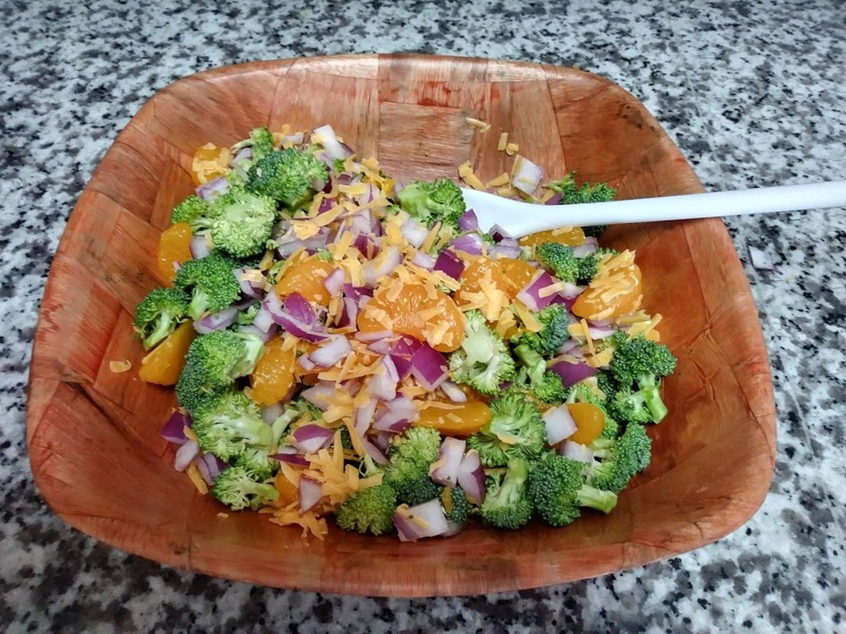 Gently combine the broccoli, onion, cheese and mandarin oranges in a bowl.