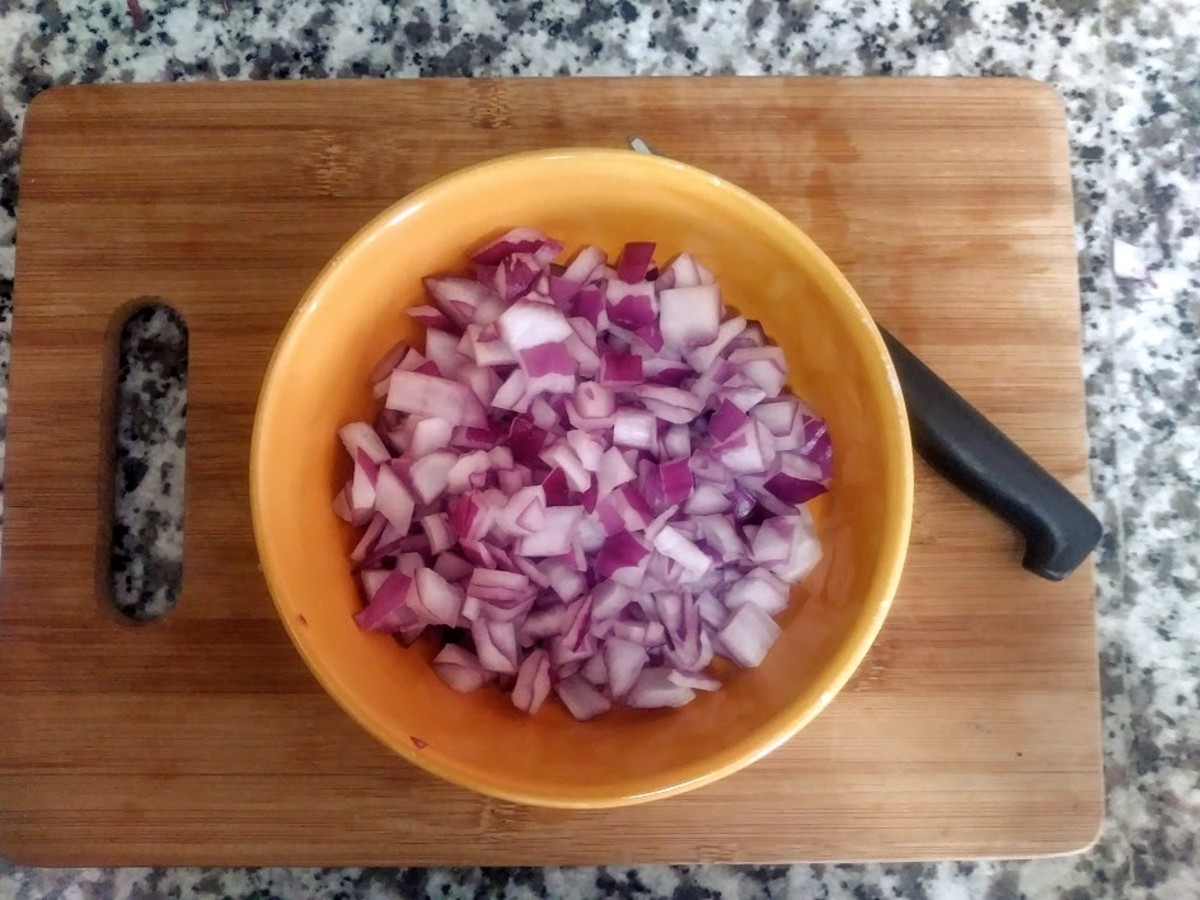 Dice the red onion and set it aside.