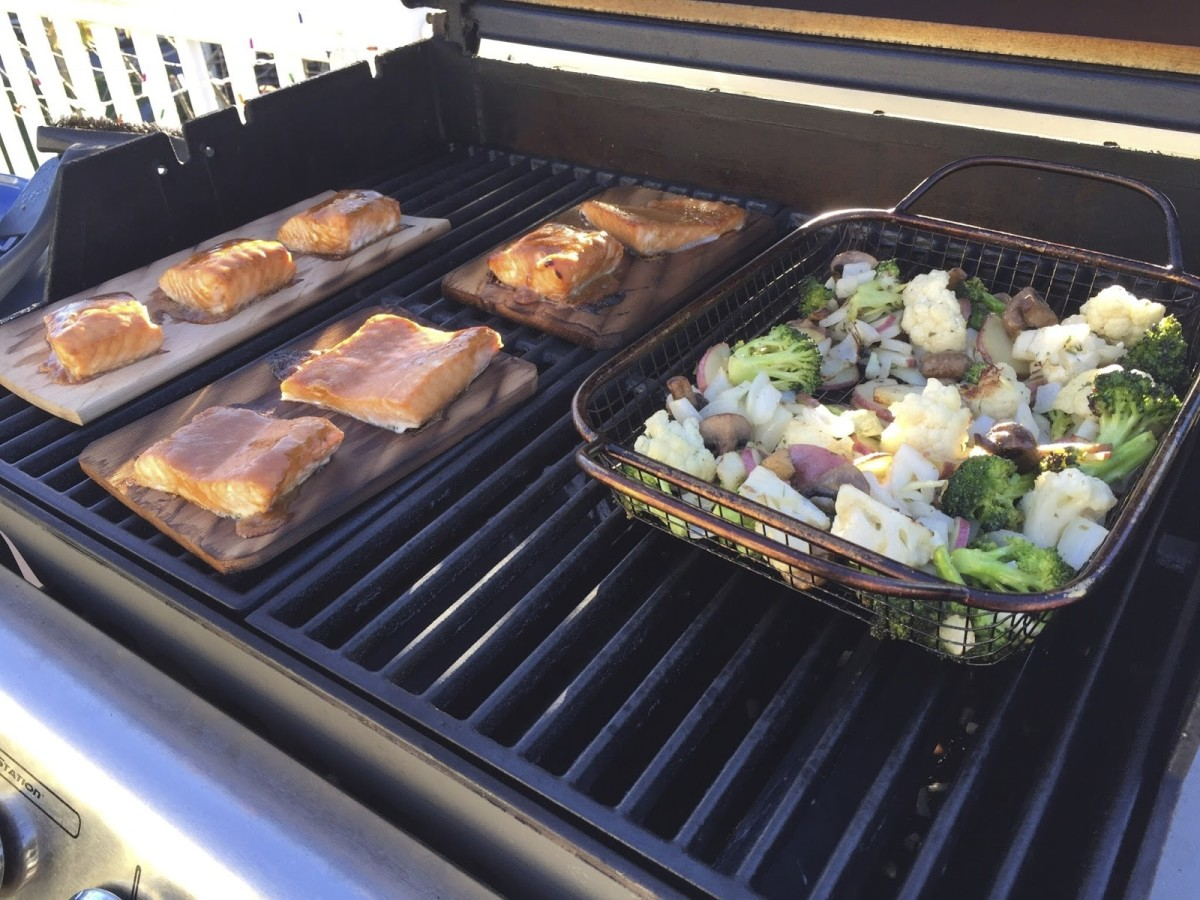 Cedar plank salmon goes great with a grill basket full of veggies!