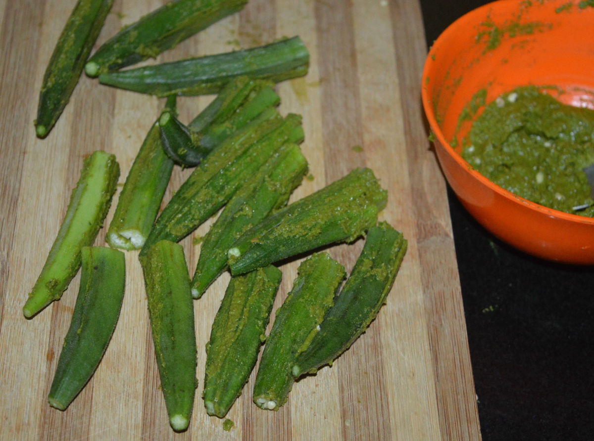 Stuff the paste inside all of the okra. If some paste remains, set aside.