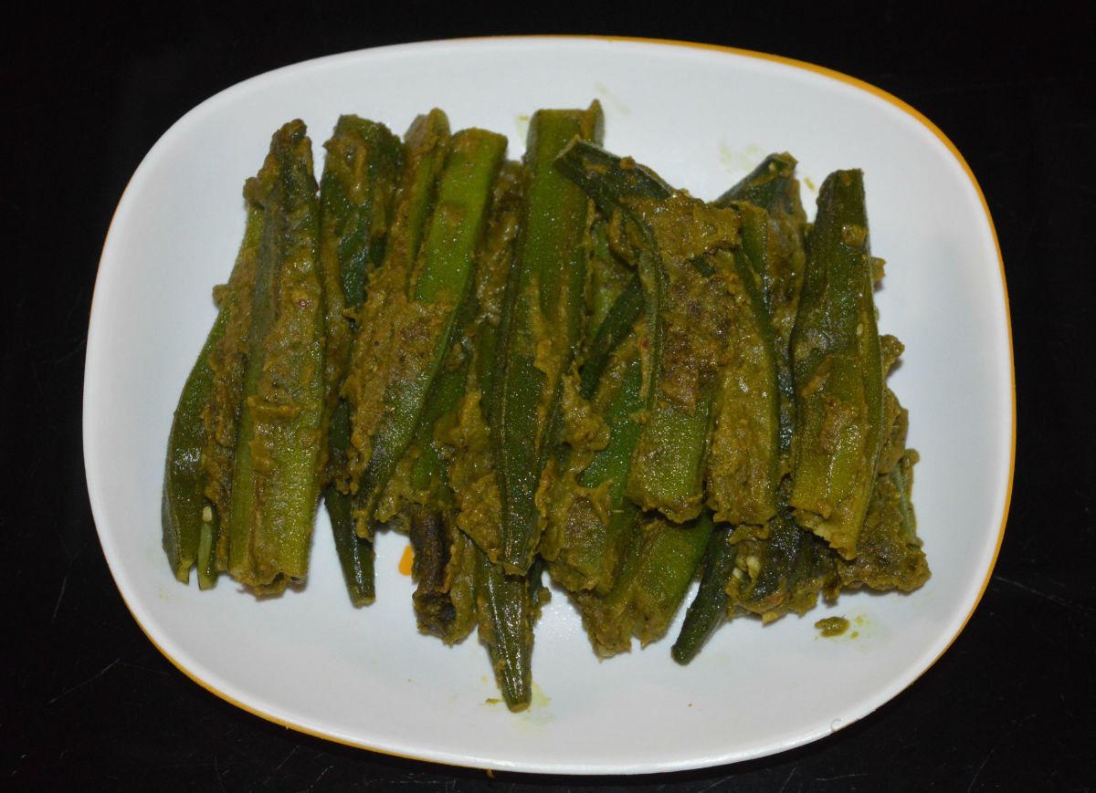 Your favorite stuffed okra is ready to serve! Arrange them on a serving plate. Enjoy eating them with flatbread, paratha, chapati, or roti. You can eat them as a healthy snack, too!