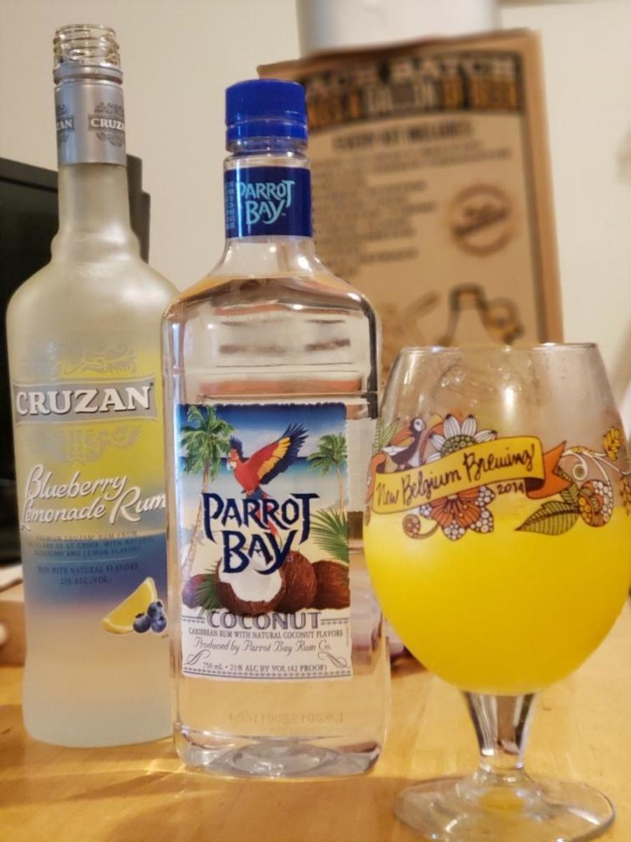 This is Nic's favorite drink. Keep the standard orange juice, ice, and Sprite and just add one ounce of coconut rum and two ounces of the blueberry lemonade rum.