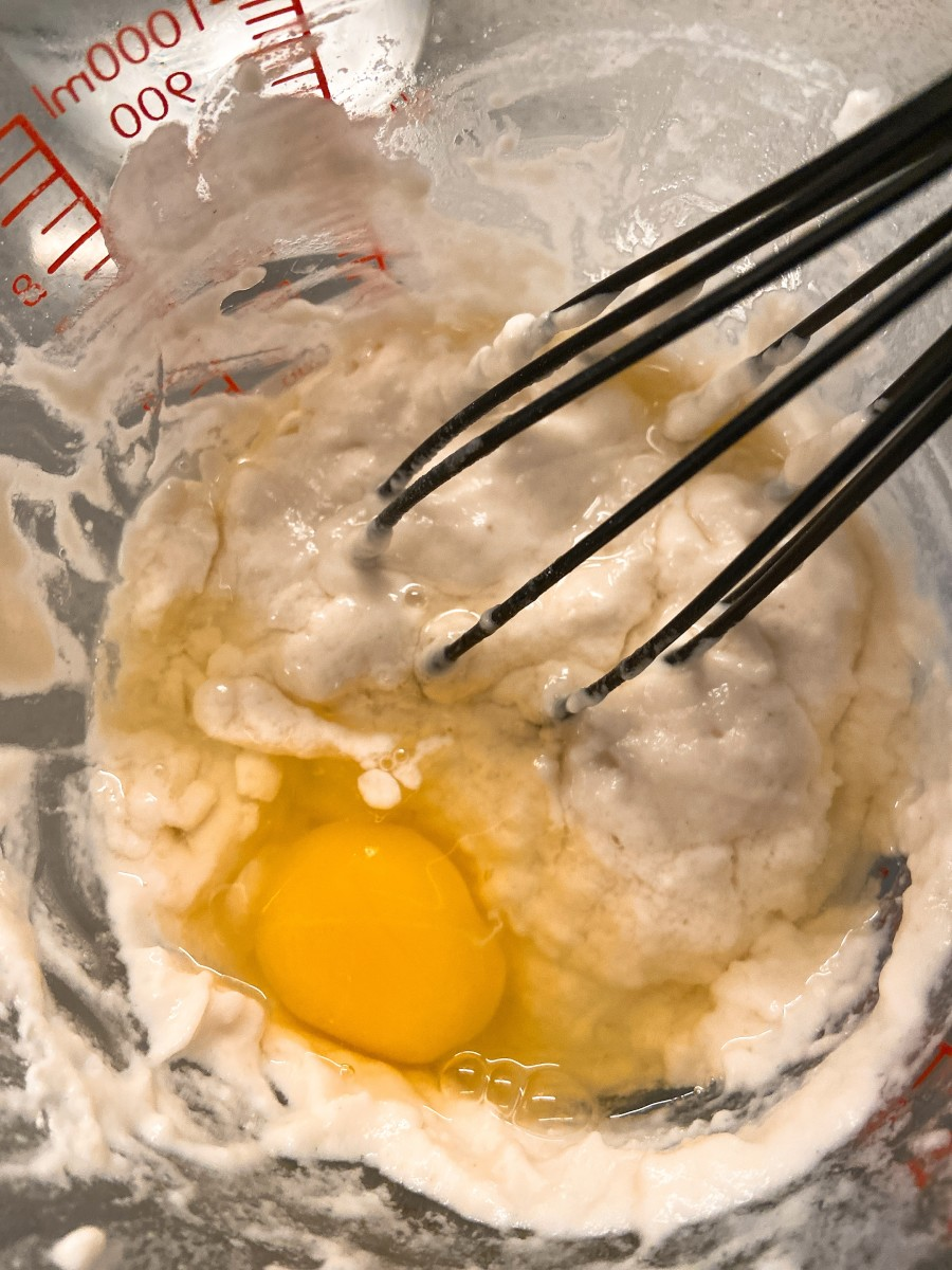 In a medium bowl, combine the flour, baking powder, baking soda, sugar, water, and egg. Mix ingredients with a whisk or hand mixer.