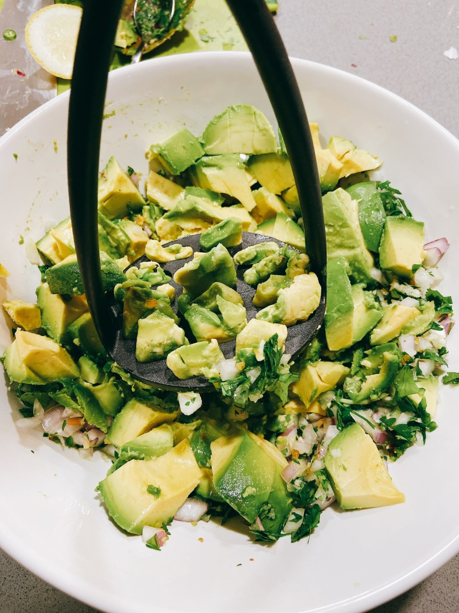 Mash the avocado with a potato masher or fork.
