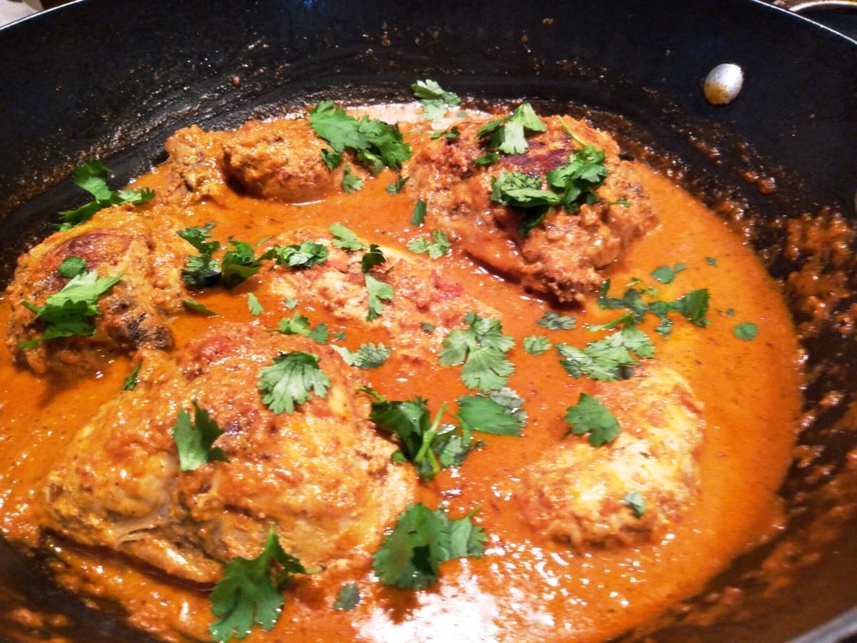 Chicken simmering in tikka masala sauce