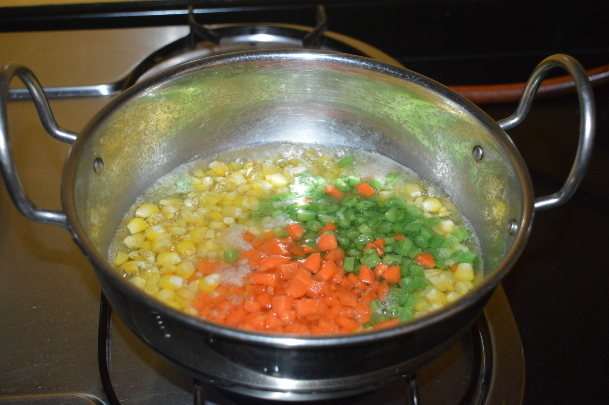 Add chopped French beans, carrots, and some salt.
