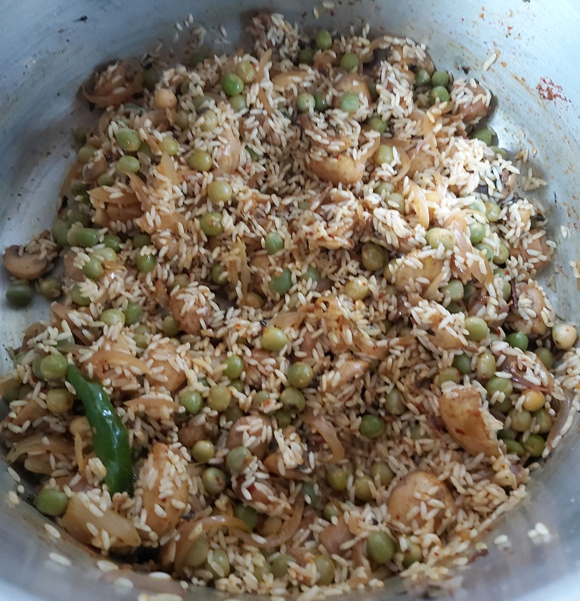 Stir gently to combine and saute the rice for a minute.