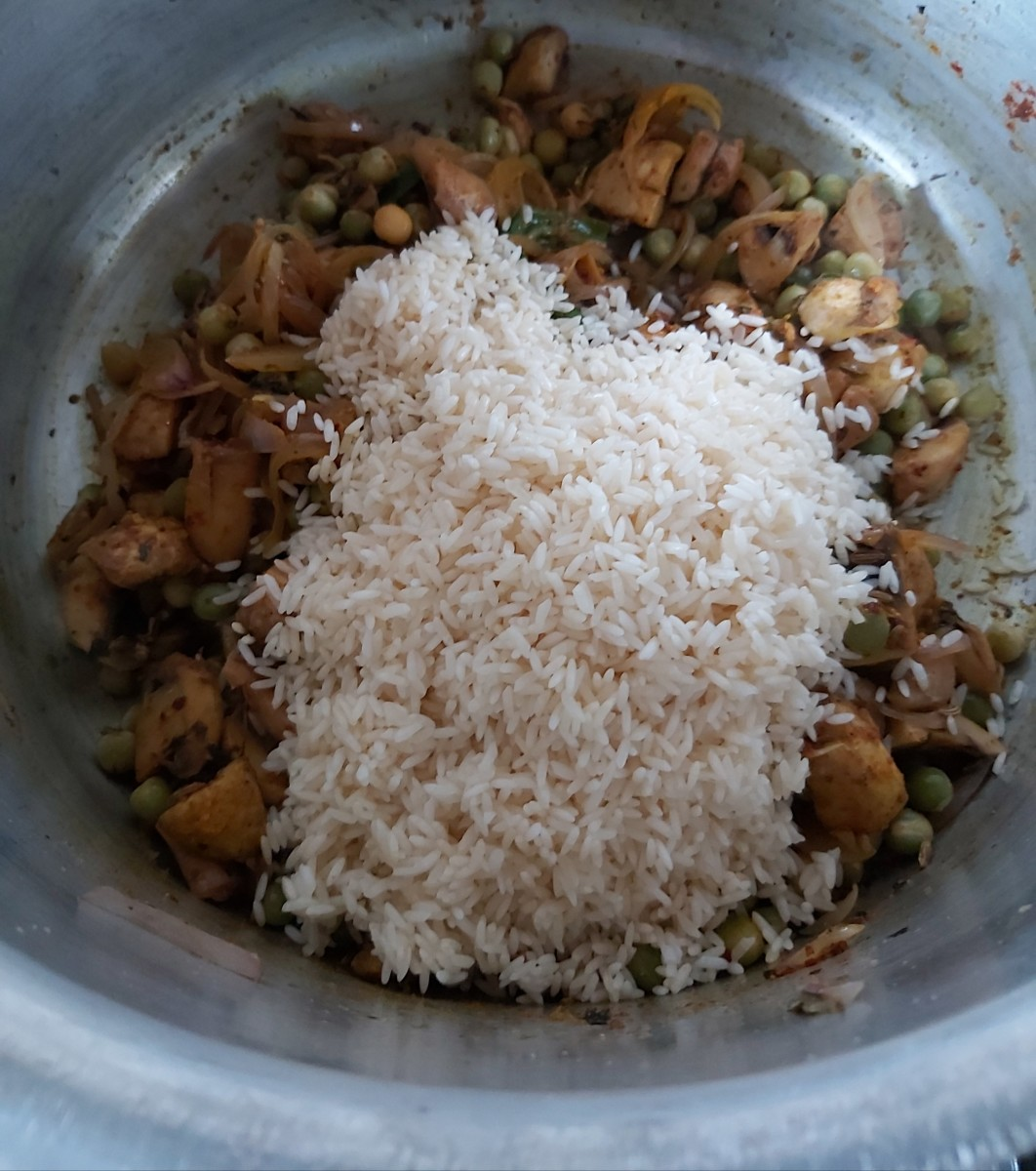 Add washed rice.