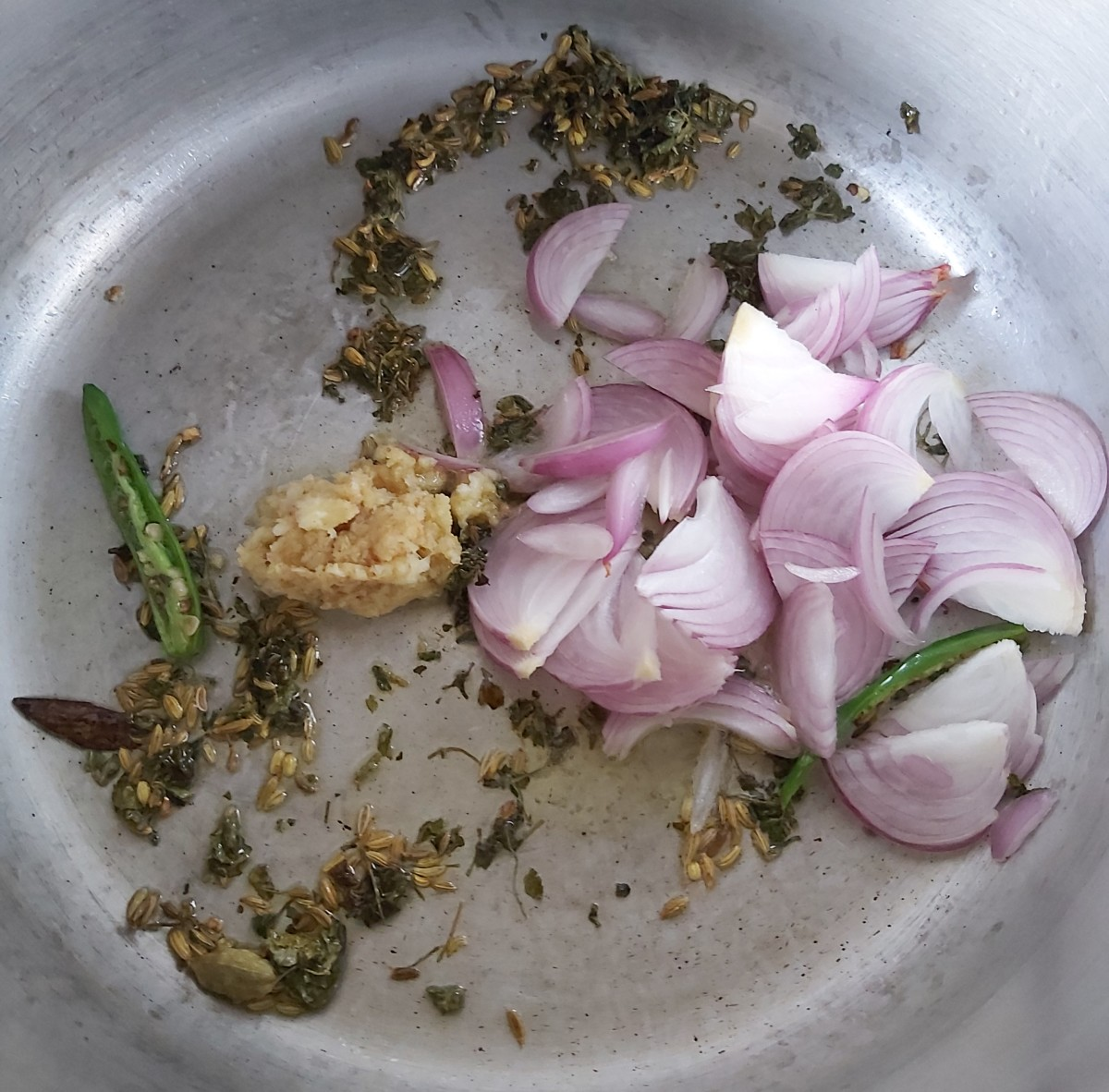 Add sliced onions and ginger-garlic paste.
