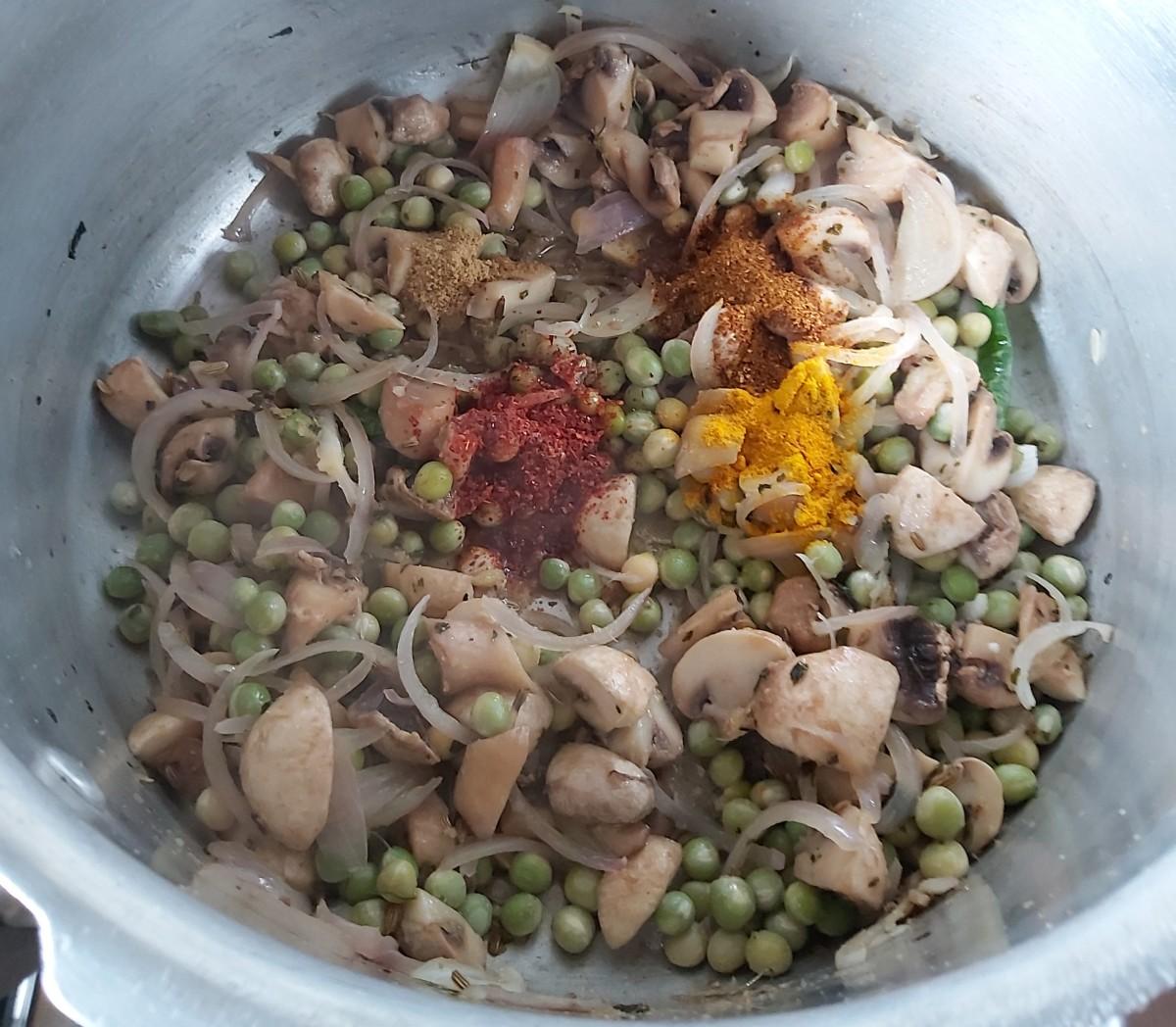 Add 1/2 teaspoon of turmeric powder, 1-2 teaspoons of red chili powder, 1-2 teaspoons of coriander powder and 1/2 teaspoon of garam masala powder.