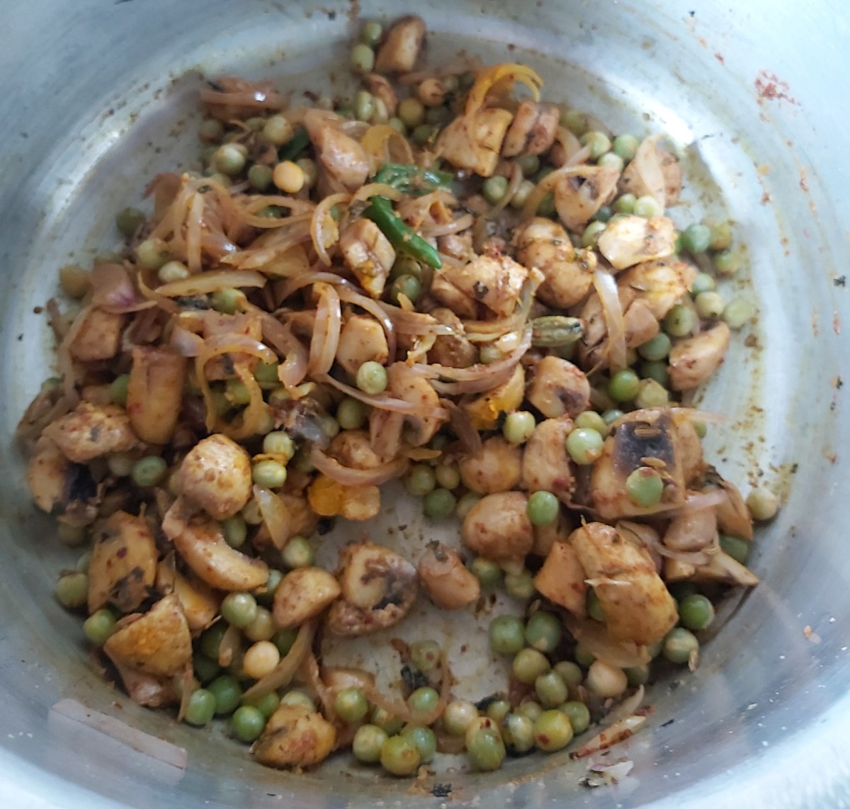 Mix and fry till vegetables coated well with spice powders and raw smell of spice powders goes away.