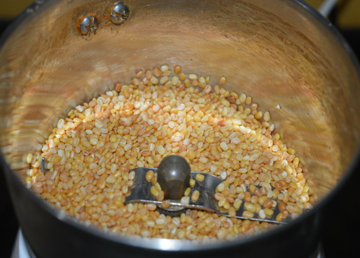 Step one: Roast the split mung beans (moong dal) until they become golden brown and give a nice aroma. Allow it to cool.