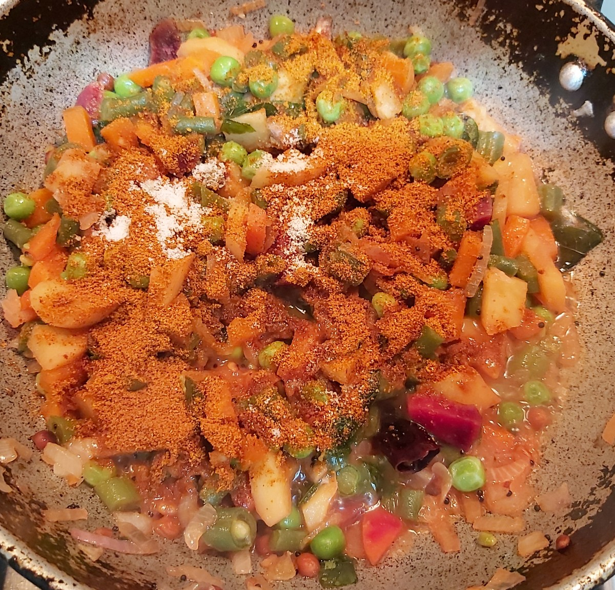 Add 2-3 teaspoons of sambar powder (I used store-bought sambar powder, you can use homemade, too) and salt to taste (vegetables are cooked with salt, so add salt sparingly).